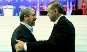 Turkey's Prime Minister and leader of ruling Justice and Development Party Erdogan welcomes his guest Hamas leader Meshaal during the AKP congress in Ankara