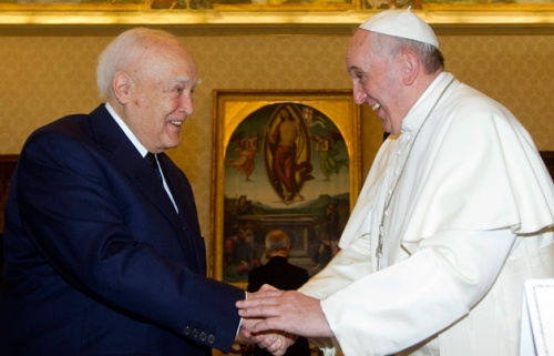 Pope Francis talks with Greece's President Karolos Papoulias during a private audience at the Vatican