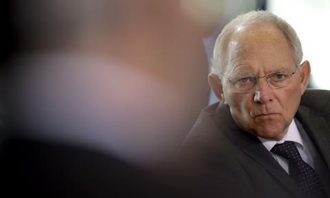 German Finance Minister Wolfgang Schaeuble attends the weekly cabinet meeting at the chancellery in Berlin, Germany, Wednesday, March 18, 2015. (AP Photo/Michael Sohn)