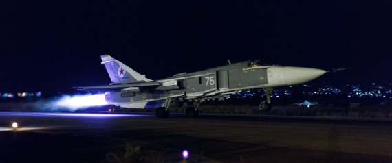 This handout photo released by the Russian Defense Ministry official web site shows a Russian Su-24 bomber taking off on a night combat mission from Hemeimeem airbase in Syria, late Thursday, Oct. 22, 2015. Russian jets regularly hit targets at night, a capability the Russian air force lacked until recently. (Vadim Savitsky/Russian Defense Ministry Press Service via AP)