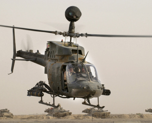 An OH-58D Kiowa Warrior helicopter from 1-4, Cavalry, 1st Infantry Division takes off from Forward Operation Base MacKenzie, Iraq for a mission Oct 23, 2004 during Operation Iraqi Freedom.  USAF photo by Staff Sgt. Shane A. Cuomo (RELEASED)