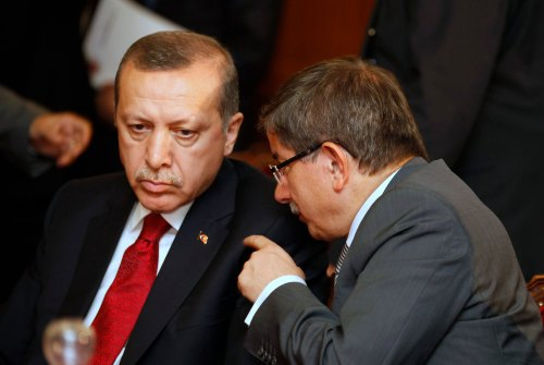 Turkey's Foreign Minister Ahmet Davutoglu (R) speaks with Turkish Prime Minister Tayyip Erdogan during a meeting at the government palace in Tunis September 15, 2011. Tunisia's new political order will show that Islam and democracy can co-exist just as they have in Turkey, Turkish Prime Minister Tayyip Erdogan said on Thursday. Erdogan, in Tunis on the second stop of a North African tour aimed at asserting Ankara's growing regional influence, said secularity should guarantee that people of all beliefs, as well as atheists, were treated fairly.    REUTERS/Zoubeir Souissi   (TUNISIA - Tags: POLITICS)