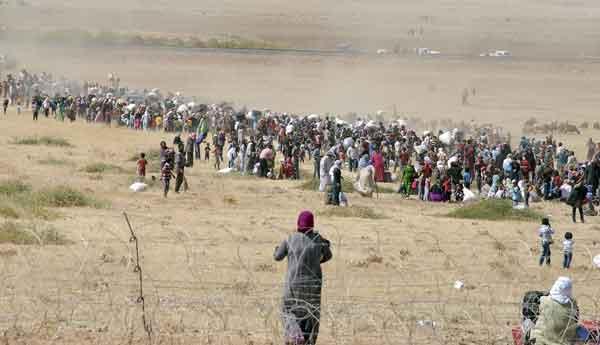 syrian-kurds-cross-turkish-border-in-droves